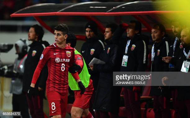 Shanghai SIPG Brazilian midfielder Oscar leaves the field after being substitute during the AFC Asian Champions League group football match between...