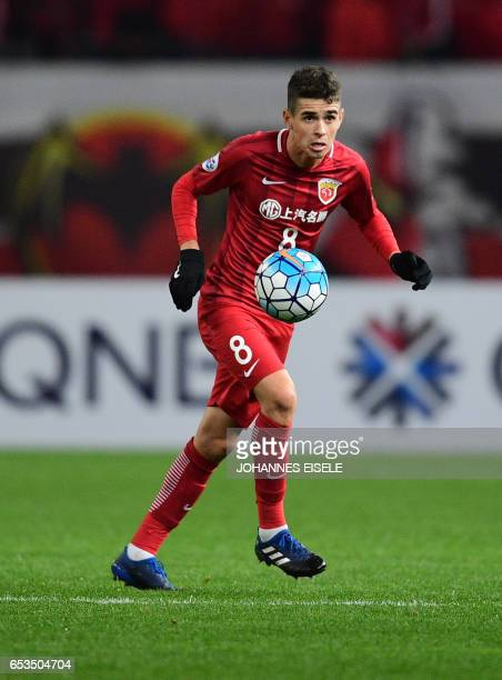 Shanghai SIPG' Brazilian midfielder Oscar vies for the ball during the AFC Asian Champions League group football match between China's Shanghai SIPG...