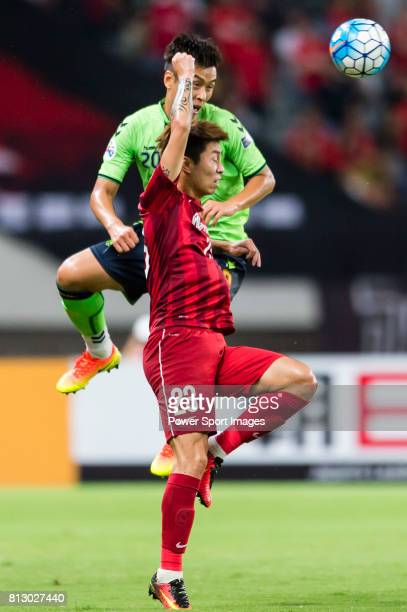 Shanghai SIPG FC defender Fu Huan fights for the ball with Jeonbuk Hyundai Motors FC forward Lee Dong Gook during the AFC Champions League 2016...