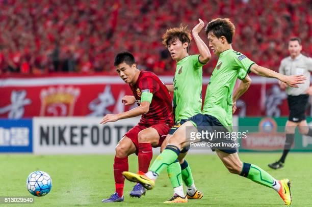 Shanghai SIPG FC defender Sun Xiang Jeonbuk Hyundai Motors FC midfielder Kim Bo Kyung and Jeonbuk Hyundai Motors FC midfielder Lee Jae Sung compete...