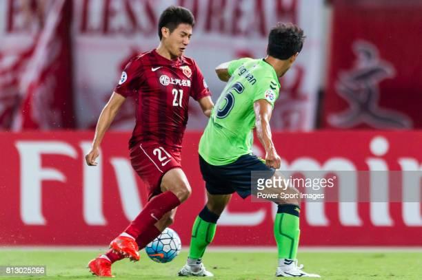 Shanghai SIPG FC forward Yu Hai fights for the ball with Jeonbuk Hyundai Motors FC defender Cho Sung Hwan during the AFC Champions League 2016...