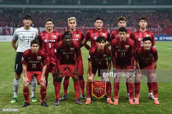 Shanghai SIPG players line up prior to the AFC Champions League playoff match between Shanghai SIPG and Muangthong United at Shanghai Stadium on...