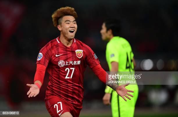 Shanghai SIPG' Shi Ke celebrates his goal during the AFC Asian Champions League group football match between China's Shanghai SIPG and Japan's Urawa...