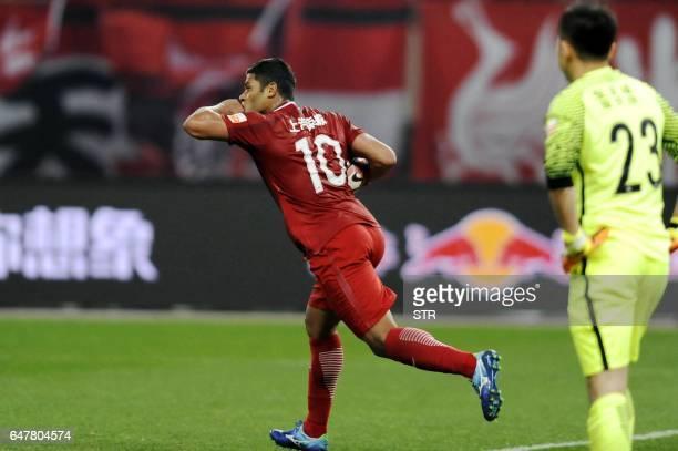 Shanghai SIPG's Brazilian forward Hulk celebrates after scoring a goal during the Chinese Super League match against Changchun Yatai in Shanghai on...