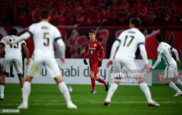Shanghai SIPG's Brazilian midfielder Oscar vies for the ball during the AFC Asian Champions League group football match between the China's Shanghai...