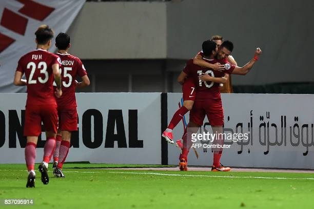Shanghai SIPG's Hulk lifts up Wu Lie after scoring a goal during the AFC Champions League quarterfinal football match between Shanghai SIPG and...