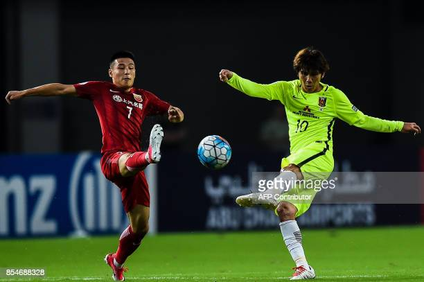 Shanghai SIPG's Wu Lei fights for the ball against Urawa' Kashiwagi Yosuke during the AFC Champions League semifinal football match between Shanghai...