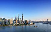 Shanghai skyline in blue sky at sunset.