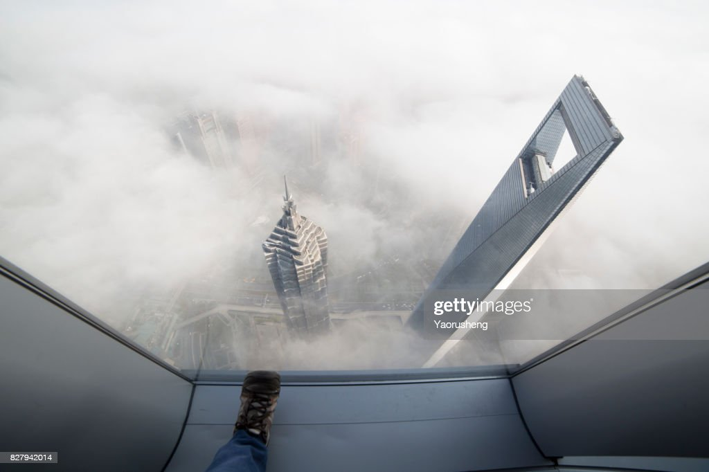 Shanghai World Finance center building in the fog,this building ,along with Jinmal building and Oriental Pear Tower are landmark of Shanghai city,located at Pudong area : Stock Photo