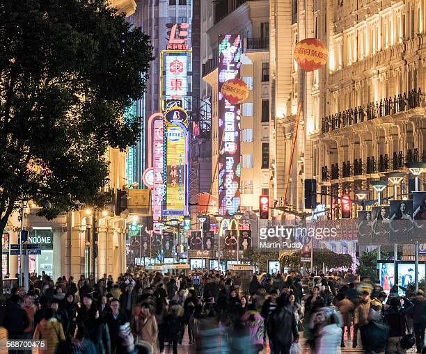 Shanghai,Nanjing road at night, busy with shoppers