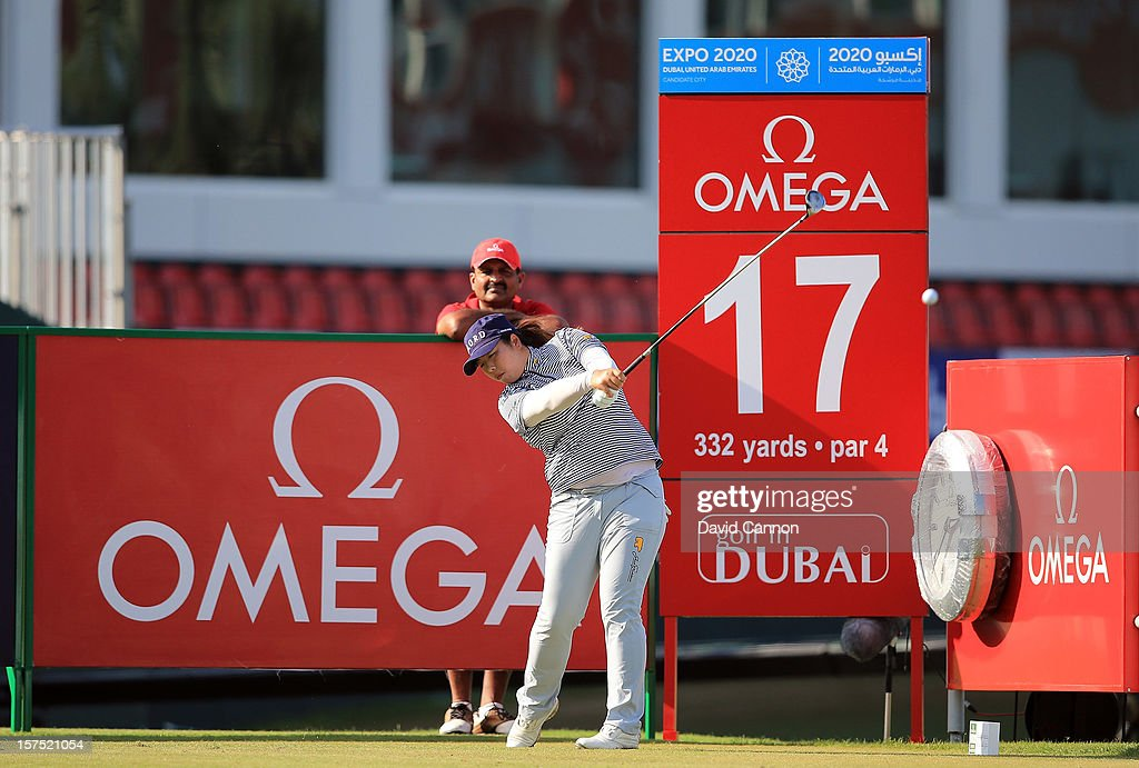Shangshan Feng of China plays her tee shot at the par 4, 17th hole during the pro-am as a preview for the 2012 Omega Dubai Ladies Masters on the Majilis Course at the Emirates Golf Club on December 4, 2012 in Dubai, United Arab Emirates.