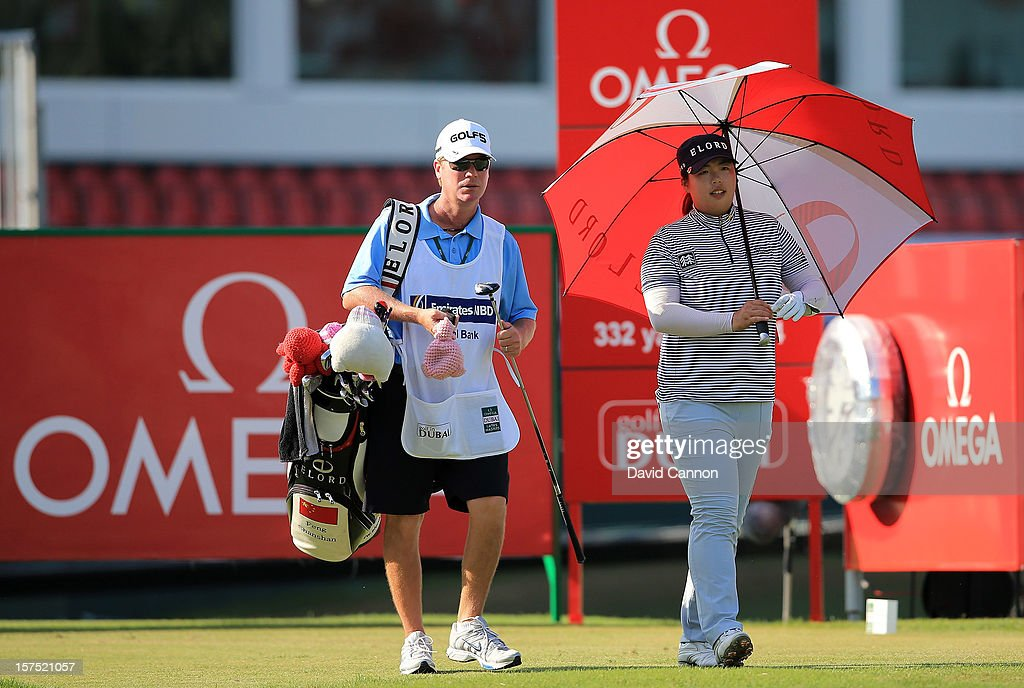 Shangshan Feng of China sheltering from the strong desert sun at the par 4, 17th hole during the pro-am as a preview for the 2012 Omega Dubai Ladies Masters on the Majilis Course at the Emirates Golf Club on December 4, 2012 in Dubai, United Arab Emirates.