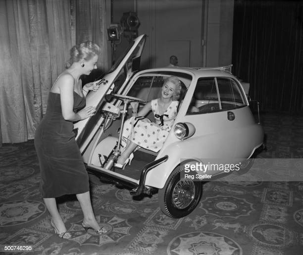 Shani Cordell and Pat Hamilton with a new Britishmade version of a BMW Isetta 300 bubble car which is on show at The Dorchester hotel London 2nd...