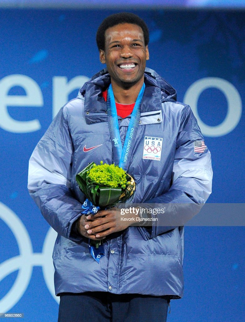 Shani Davis of United States celebrates winning the gold medal during the medal ceremony for the Men�s 1000m Speed Skating on day 7 of the Vancouver...