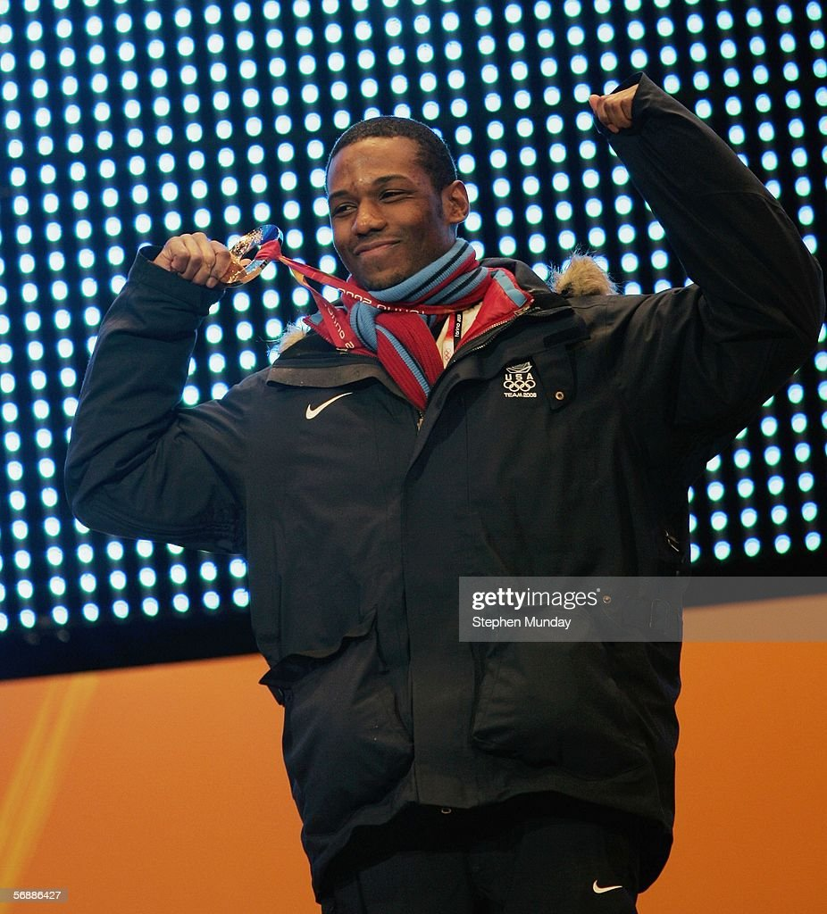 Shani Davis of United States receives the Gold medal in the men's 1000m speed skating final during the Medals Ceremony on Day 9 of the Turin 2006...