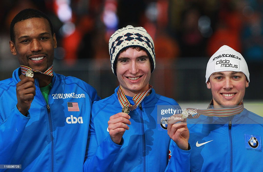 Shani Davis Trevor Marsicano and Jonathan Kuck of USA take place on the podium for first place of the mens Team Persuit race during Day 4 of the...