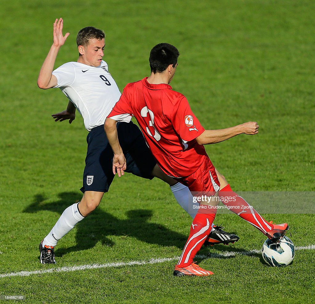 Shani Tarashaj of Switzerland and Harry Toffolo of England in action during the UEFA U19 Championships Qualifier between England and Switzerland, on October 15, 2013 in Ptuj, Slovenia.