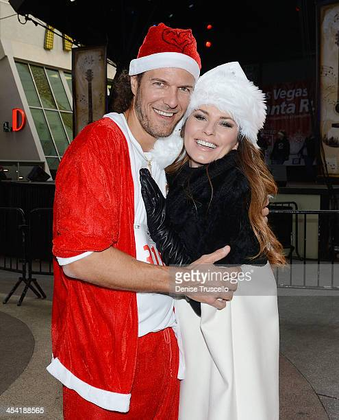 Shania Twain meets her husband Frederic Thiebaud at the finish line after his participation in the 9th annual Opportunity Village Great Santa Run in...