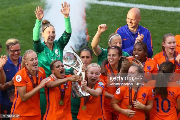 Shanice van de Sanden and Kika van Es of the Netherlands lift the trophy on the podium after winning the Netherlands v Denmark UEFA Women's Euro 2017...