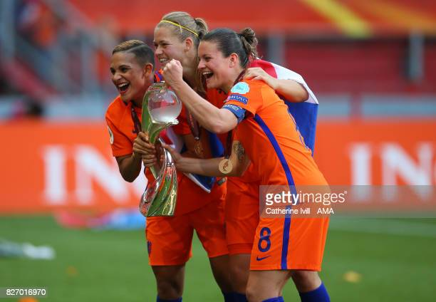 Shanice Van de Sanden Anouk Dekker and Sherida Spitse of Netherlands Women celebrate after the UEFA Women's Euro 2017 final match between Denmark and...