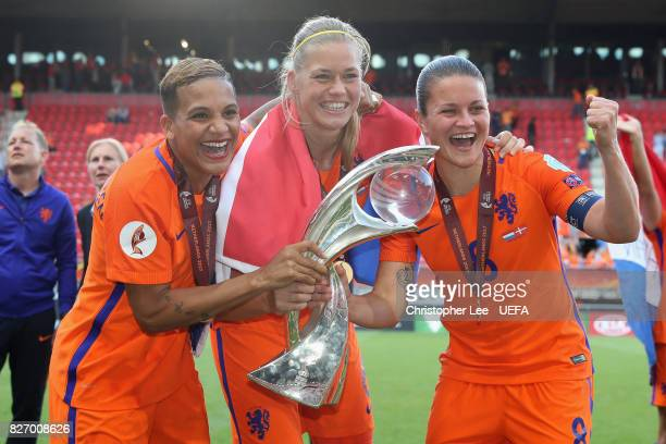 Shanice van de Sanden Anouk Dekker and Sherida Spitse of the Netherlands celebrate with the trophy following the Final of the UEFA Women's Euro 2017...