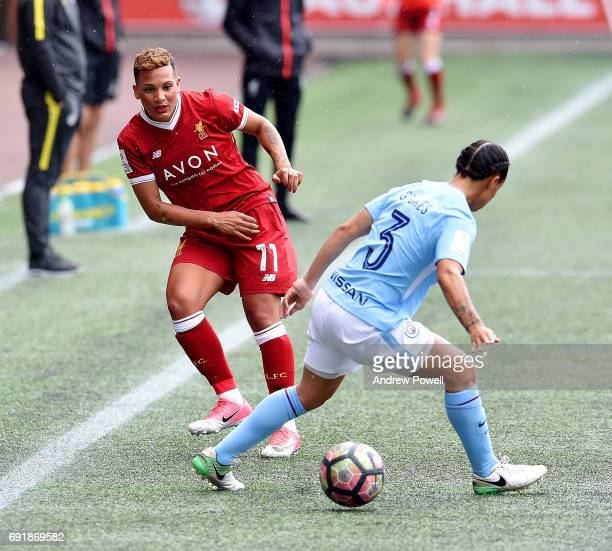 Shanice Van De Sanden of Liverpool Ladies competes with Demi Stokes of Manchester City Women during a WSL 1 match between Liverpool Ladies and...