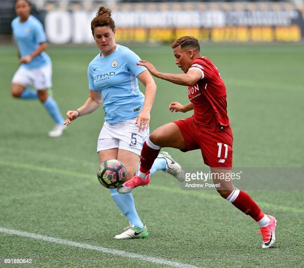 Shanice Van De Sanden of Liverpool Ladies competes with Jennifer Beattie of Manchester City Women during a WSL 1 match between Liverpool Ladies and...