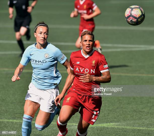 Shanice Van De Sanden of Liverpool Ladies competes with Lucy Bronze of Manchester City Women during a WSL 1 match between Liverpool Ladies and...