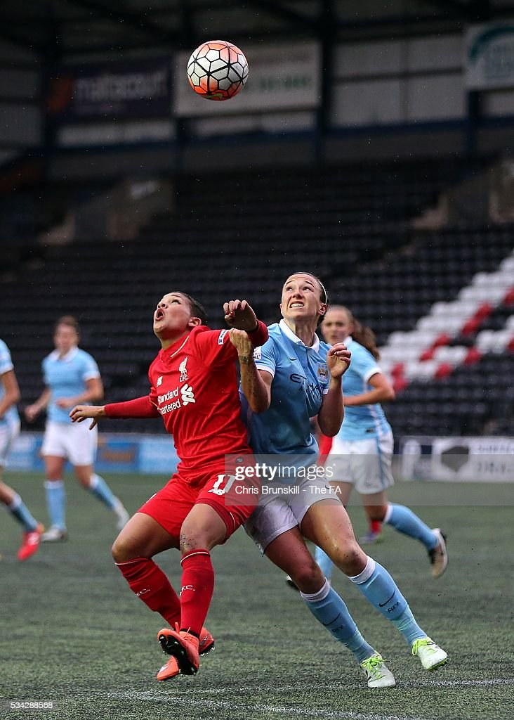 Shanice Van De Sanden of Liverpool Ladies FC in action with <a gi-track='captionPersonalityLinkClicked' href=/galleries/search?phrase=Lucy+Bronze&family=editorial&specificpeople=5584928 ng-click='$event.stopPropagation()'>Lucy Bronze</a> of Manchester City Women during the FA WSL match between Liverpool Ladies FC and Manchester City Women at the Halton Stadium on May 25, 2016 in Widnes, England.