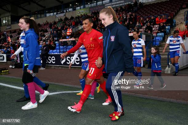 Shanice van de Sanden of Liverpool Ladies walk onto the pitch with her mascot during the WSL 1 match between Liverpool Ladies and Reading FC Women at...