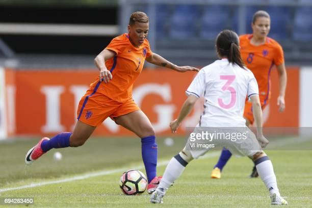 Shanice van de Sanden of the Netherlands Aya Sameshima of Japanduring the friendly match between the women of The Netherlands and Japan at the Rat...