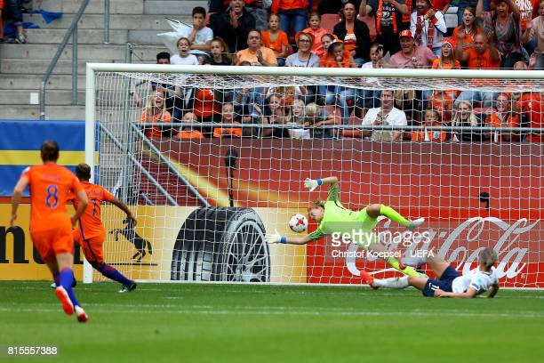 Shanice van de Sanden of the Netherlands scores the first goal against Ingrid Hjelmseth of Norway during the UEFA Women's Euro 2017 Group A match...