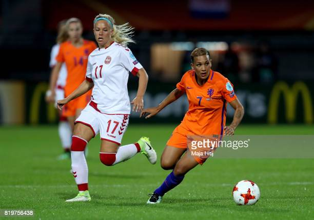 Shanice van de Sanden of the Netherlands takes the ball past Katrine Veje of Denmark during the UEFA Women's Euro 2017 Group A match between...