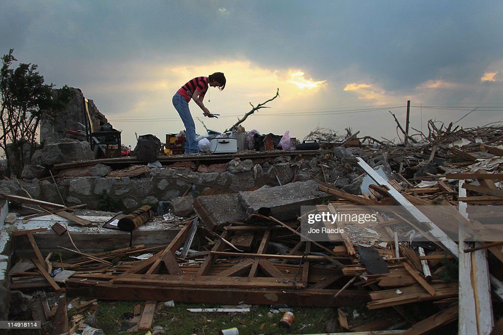 Shanie Spencer salvages what she can from what remains of her house on May 28, 2011 in Joplin, Missouri. After the town was hit by a massive tornado that killed at least 142 people, denizens continue the process of recovering from the storm.