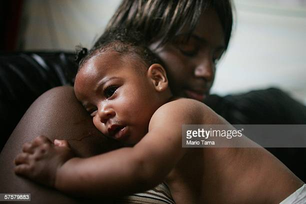 Shanika Reaux holds her baby Tatiana Lewis 6 months in their residence in the devastated Lower Ninth Ward May 9 2006 in New Orleans Louisiana Reaux's...