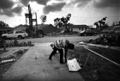 Shanika Reaux picks up a piece of trash in the driveway of her Lower Ninth Ward residence May 9 2006 in New Orleans Louisiana Reaux's home in the...