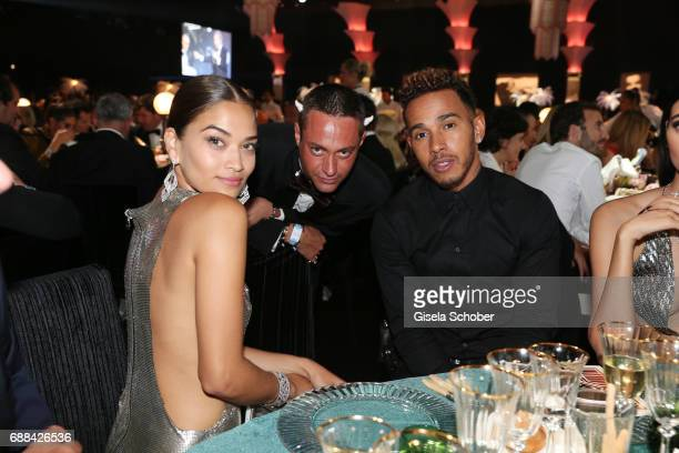 Shanina Shaik Pietro Tavallini and Lewis Hamilton attend the amfAR Gala Cannes 2017 at Hotel du CapEdenRoc on May 25 2017 in Cap d'Antibes France