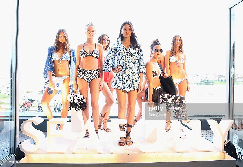 <a gi-track='captionPersonalityLinkClicked' href=/galleries/search?phrase=Shanina+Shaik&family=editorial&specificpeople=5556870 ng-click='$event.stopPropagation()'>Shanina Shaik</a> (C) poses amongst models during the Seafolly Spring 2016 Campaign Launch at North Bondi Fish on June 30, 2016 in Sydney, Australia.