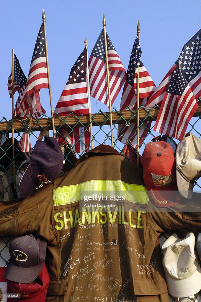 A Shanksville fireman's coat joins the flags, caps, helmets and other gifts as part of the temporary memorial at the Flight 93 crash site September 11, 2003 in Shanksville, Pennsylvania. The plane crashed September 11, 2001 into a rural field from the presumed target of the nation's capital, killing 40 men and women.