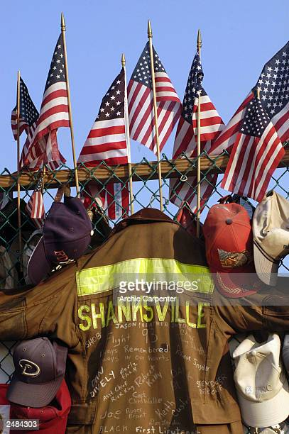 Shanksville fireman's coat joins the flags caps helmets and other gifts as part of the temporary memorial at the Flight 93 crash site September 11...