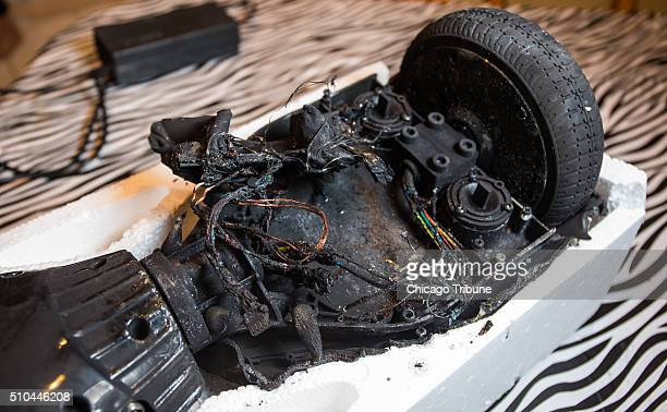 Shanna Abraham with remains of her hoverboard at home in Orland Park Ill on Monday Feb 15 2016 The hoverboard exploded over the weekend while...