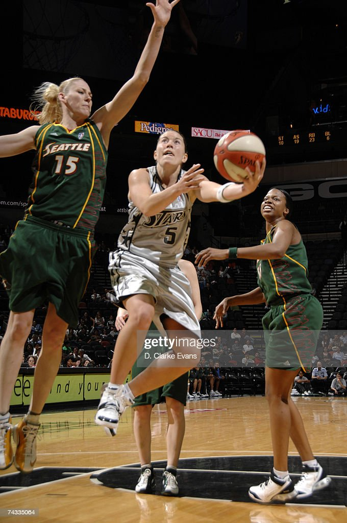 Shanna Crossley #5 of the San Antonio Silver Stars shoots against Lauren Jackson #15 of the Seattle Storm during the game at the AT&T Center on May 25, 2007 in San Antonio, Texas.