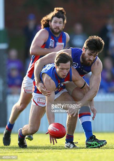 Shannen Lange of Port Melbourne is tackled by Tom Campbell of Footscray during the VFL Preliminary Final match between the Footscray Bulldogs and...