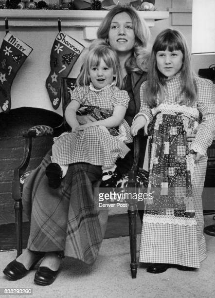 Shannon and Missy Sidwell pose with their mother prior to the anticipated arrival of Santa Claus who will fill their Christmas stockings Twoyearold...