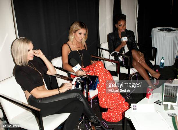 Shannon Bex Aubrey O'Day and Dawn Richards attend Flips Audio Headphones Sponsors the Official Artist Gift Lounge Cumulus Radio Row At the American...