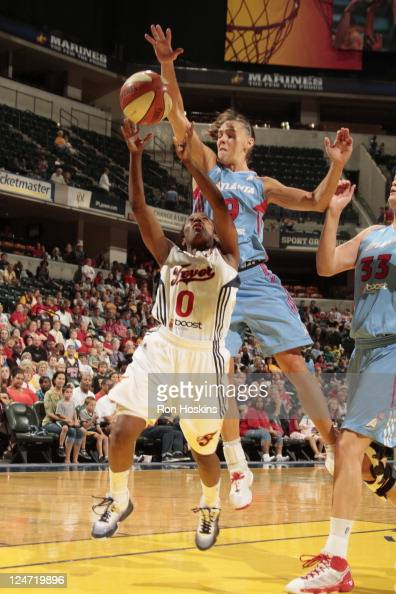 Shannon Bobbitt of the Indiana Fever gets fouled by Coco Miller of the Atlanta Dream at Conseco Fieldhouse on September 11 2011 in Indianapolis...