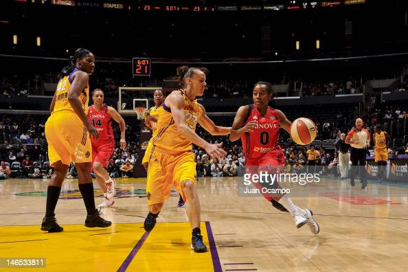 Shannon Bobbitt of the Washington Mystics drives against Coco Miller of the Los Angeles Sparks at the Staples Center on June 18 2012 in Los Angeles...