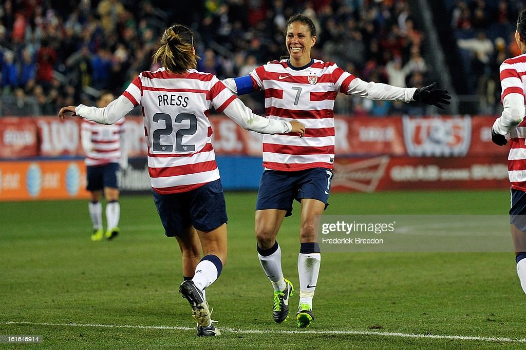 <a gi-track='captionPersonalityLinkClicked' href=/galleries/search?phrase=Shannon+Boxx&family=editorial&specificpeople=678532 ng-click='$event.stopPropagation()'>Shannon Boxx</a> #7 of the U.S. Women's National Team congratulates teammate Christen Press #22 on scoring a goal against the Scotland Women's National Team at LP Field on February 13, 2013 in Nashville, Tennessee.