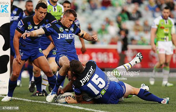 Shannon Boyd of the Raiders is stopped short of the try line during the round 11 NRL match between the Canberra Raiders and the Canterbury Bulldogs...