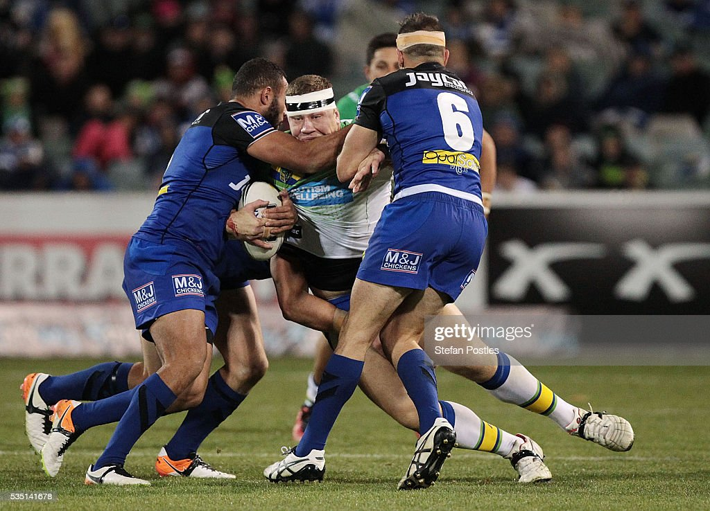 Shannon Boyd of the Raiders is tackled during the round 12 NRL match between the Canberra Raiders and the Canterbury Bulldogs at GIO Stadium on May 29, 2016 in Canberra, Australia.